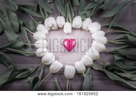 Love bright tulips heart lovely surprise present for girlfriend. Beautiful heart shape on wood in decoration one at one tulip. Wonderful gift for e.g. valentine's day mother's day wedding birthday or anniversary.