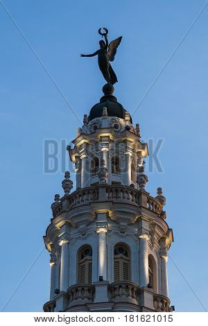 The Giraldilla (the symbol of the Cuban capital Havana) on the top of Gran Teatro de La Habana hotel in the heart of the city. This was captured just after sunrise one morning with a lovely mix of ambient & artificial light.