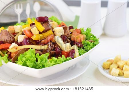 Warm salad with chicken liver, beans, tomatoes, sweet paprika, croutons and balsamic dressing.