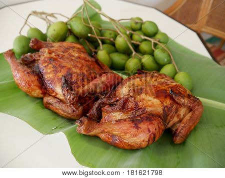 Roasted chicken (lechon manok) and green mangoes