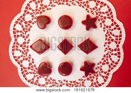 handmade Red marmalade in molds white napkin overhead view