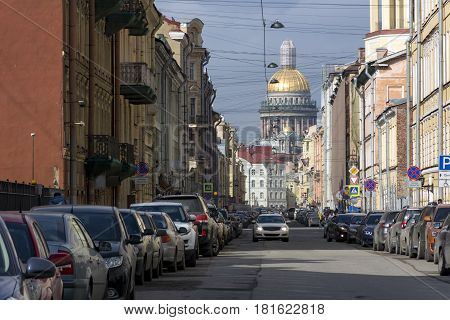 cars on a city street building home away Isaac's Cathedral the Golden dome the view of the city of Petersburg