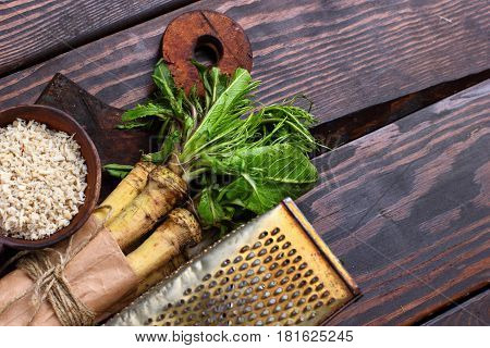 Raw Horseradish Roots On Wooden Background. Horseradish With Leaves.homemade Wassabi.top View.copy S