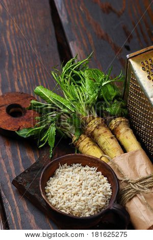 Raw Horseradish Roots On Wooden Background. Horseradish With Leaves.homemade Wassabi