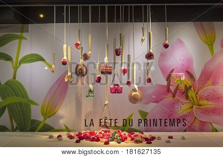 PARIS FRANCE - MARCH 27 2017: Fashion accessories in the showcase of the Printemps department store in Paris France. Spring and summer theme.