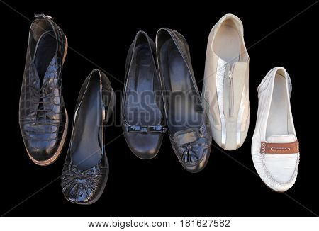 Closeup of six different casual vintage women shoes isolated on black background.