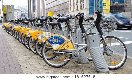 BRUSSELS BELGIUM - JULY 30 2014: Yellow bicycles of self-service Villo for rent in historical center of Brussels.
