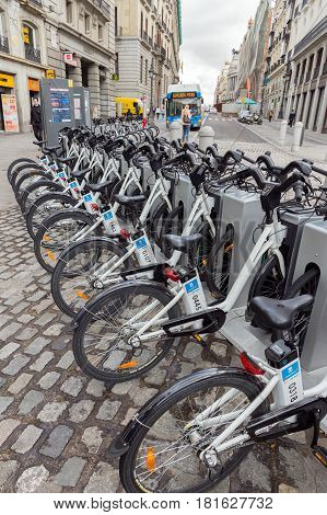 MADRID SPAIN - OCT 10 2014: Bikes parked on the sidewalk belonging to Madrid public system (BiciMad) in Madrid.