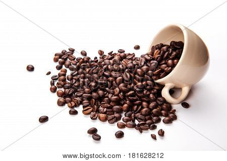 Coffee beans in coffee cup isolated on white and