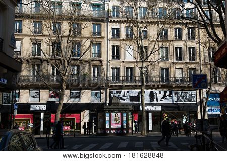 PARIS FRANCE - MARCH 27 2017: Boulevard Saint Michel on sunny day shopping street near Sorbonne University and Notre Dame Cathedral. French landmarks and travel destinations concept.
