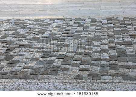 Ancient roman dilapidated small square stone paving in Rimini