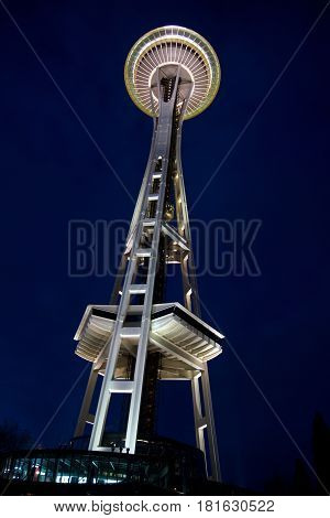 SEATTLE, WASHINGTON, USA - JAN 25th, 2017: Space Needle against a dark blue sky clear night as viewed from the ground.