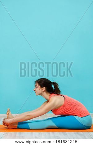 Photo of girl in sportswear doing yoga