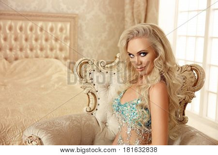 Beautiful Blond Bride Woman Portrait Posing On Baroque Armchair In Modern Luxurious Interior. Fashio