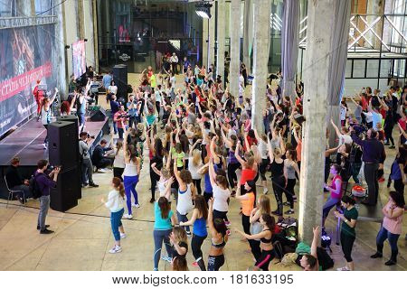 MOSCOW - APR 16, 2016: Many women dance on fitness workout in DI Telegraph. Everyone will be able to exercise free of charge at Reebok sites in Moscow park