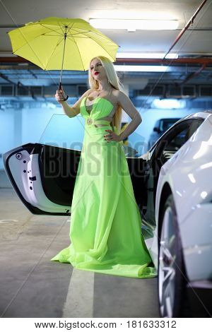 MOSCOW - MAY 20, 2016: Woman (with MR) pose near at Lamborghini Huracan LP 610-4 in parking. Lamborghini Huracan is world first production car, using inertial navigation system