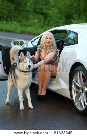 MOSCOW - MAY 20, 2016: Beautiful woman (with MR) with husky near Lamborghini Huracan LP 610-4. Lamborghini Huracan is world first production car, using inertial navigation system