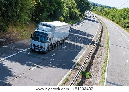 Road transport White lorry in motion on the motorway