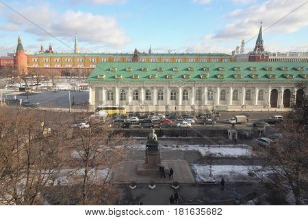 Road, monument, Central Exhibition Hall Manege, Kremlin walls and towers far away in Moscow, Russia at winter