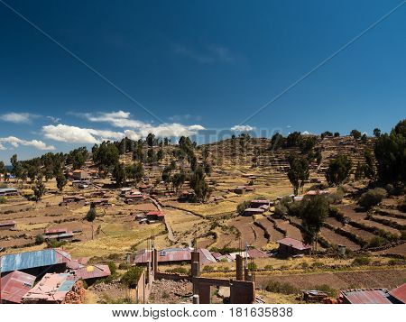 Landscape of the farming terraces on Taquile Island, in Lake Titicaca, Peru.