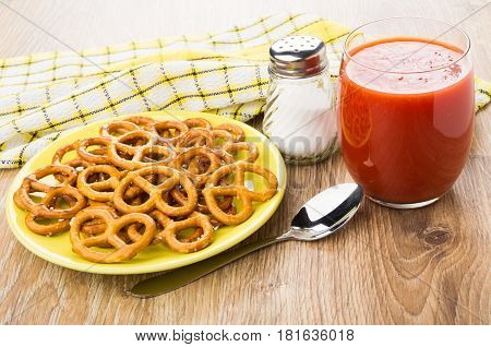 Salted Pretzels In Saucer, Salt, Tomato Juice And Spoon