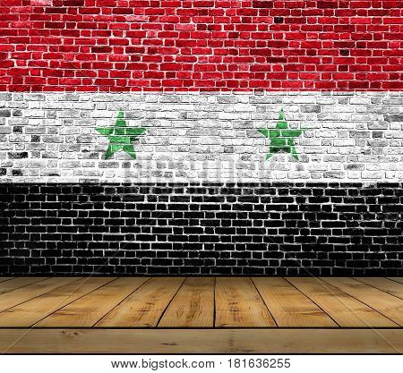 Syria flag painted on brick wall with wooden floor