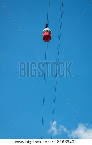 Barcelona red cable car on a blue sky background