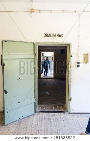 Entrance Of The Gas Chamber Of Dachau Concentration Camp. On The Sign Puts