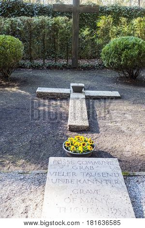 Grave With The Ashes Of Those Killed In The Concentration Camp Of Dachau.