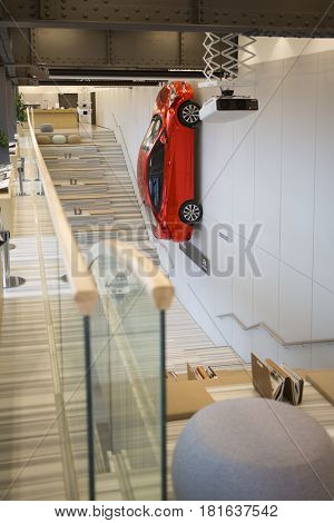 MOSCOW - APR 16, 2016: Red Hyundai Solaris modelon wall in Hyundai Motorstudio. Hyundai produces not only cars, but also its own collection of furniture and household items