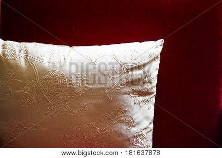 White Pillow Cushion On Dark Red Background