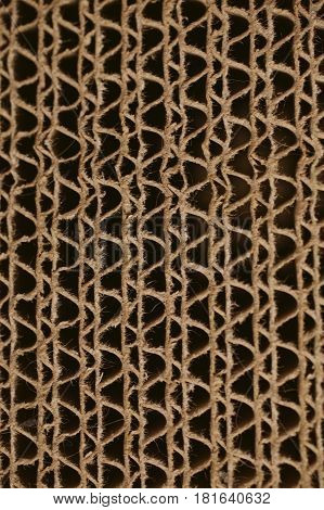 Macro texture of cardboard. Cardboard corrugated pattern. Abstract texture and background for designers. Brown paper texture and pattern. Closeup view of cardboard background.