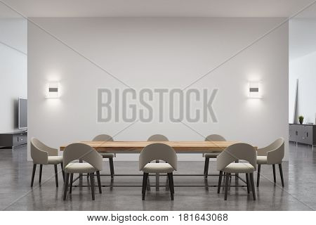 Dining room interior with a long wooden table surrounded by chairs and an empty white wall with two lamps on it. 3d rendering mock up