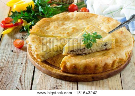A Classic Quiche Lorraine Pie With Potatoes, Cabbage, Fish And Cheese On A Wooden Table. Place For T
