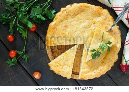 Classic Quiche Lorraine Pie With Potatoes, Cabbage, Fish And Cheese On A Wooden Table. Top View.