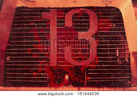 13 thirteen unlucky number with grunge blood stain front of truck