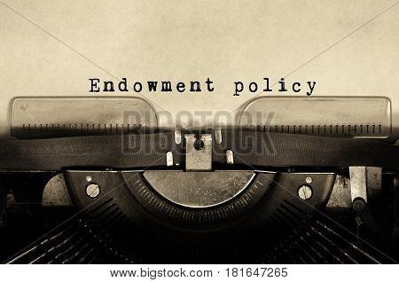 Endowment policy words typed on vintage typewriter.