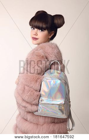 Brunette Smiling Teen Girl In Pink Fur Coat Advertise Backpack, Young Stylish Beautiful Woman. Fashi