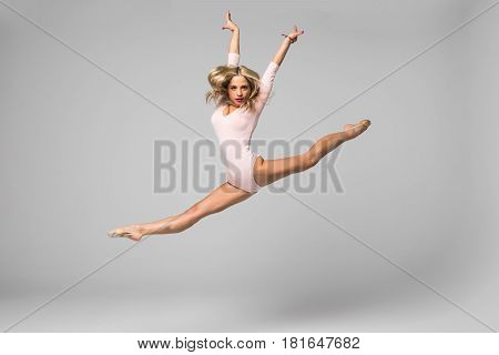 Jumping Professional Gymnast Girl Dancer Isolated On Studio Background