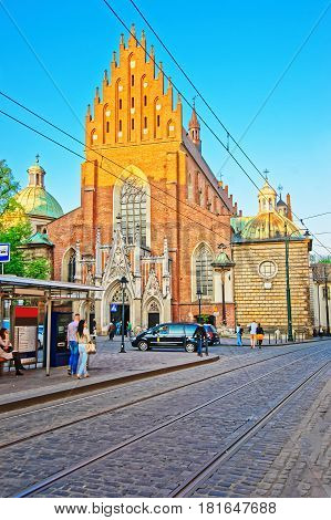 Krakow Poland - May 1 2014: Holy Trinity Church in the old town of Krakow Poland. People on the background