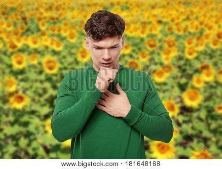 Seasonal allergy. Young sick man outdoor