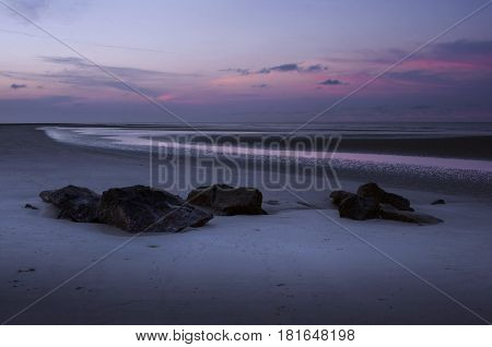 Beautiful pink and blue hues of a sunrise on Isle of Palms near Charleston, South Carolina on a spring morning