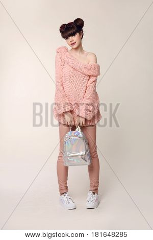 Fashion Style Teen Look. Fashionable Young Girl Wears In Wool Sweater And Leather Pants, Superstar S