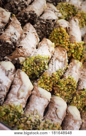 Sicilian Cannoli in a row on the tray
