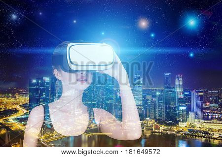 Portrait of a young woman in a tank top wearing vr glasses in a city at night. Toned image double exposure.