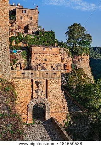 Sorano, Grosseto, Tuscany, Italy: landscape from the medieval village with the ancient city walls and the old town gate Porta dei Merli at the bottom
