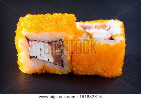 Roll Mr.krabs Isolate On A Black Slate Board - Red Tobiko Caviar, Mayonnaise, Crab Meat (imitation),
