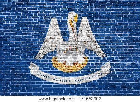 Louisiana US flag painted on old vintage brick wall