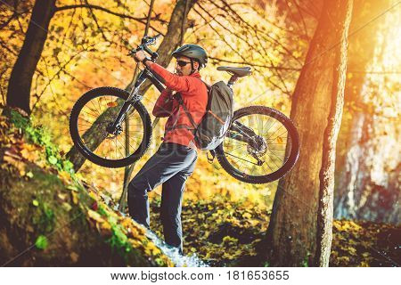 Caucasian Biker Uphill Walk with Bike. Mountain Trail Biking.