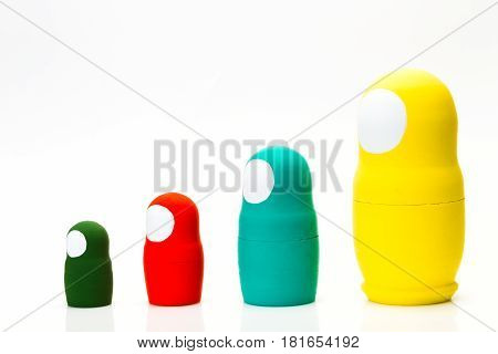 Wooden multi-colored toy nuts on white background, studio light
